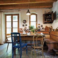 Seating area with corner bench in rustic kitchen