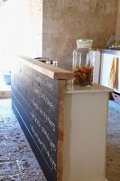 Glass jar of madeleines on kitchen island with blackboard front in Chateau Maignaut