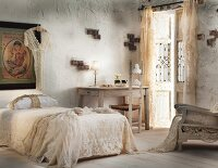 Romantic bedroom with lacy bedspread & curtains