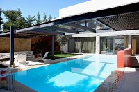 Contemporary terrace with central swimming pool and transverse roof