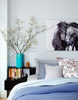 Bed with Bedside Table and Horse Print Above Bed