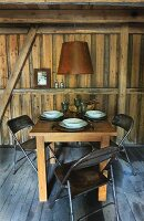Set table in wooden cabin