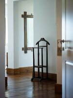 Vintage-style valet stand in minimalist foyer