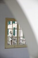 Restricted view of historic facade of country manor (Schloss Schauenstein) through lattice window