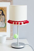 Table lamp decorated with pompom trim & pompom on light pull
