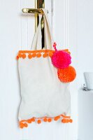Cloth bag decorated with pompons & pompom trim