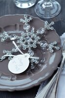 Name tag on glass snowflake on plate