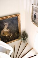 Framed picture in stairwell; white stair treads with contrasting black edges