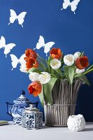 Vase of tulips, teapots and butterfly wall stickers