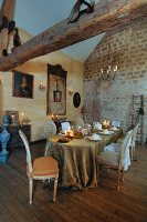 Long table festively set in stylish, vintage Rococo style in old, French country hose