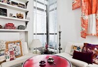 Red table and sofas with collection of printed scatter cushions