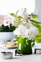 Bouquet of lilies, freesias & viburnum decorated with pastry cutters