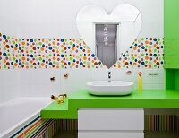 Colourful child's bathroom with heart-shaped mirror