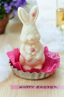 White chocolate Easter bunny on tissue paper in tartlet tin and Easter greeting on washi tape