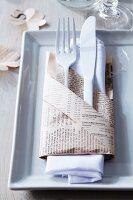 Cutlery in newspaper pocket