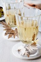 Wine glasses with newspaper drip collars