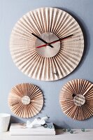 Wall-mounted clock and ornaments made from folded newspaper
