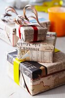 Gift boxes wrapped in newspaper with decorative hearts