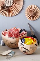 Wall decorations and dishes hand-crafted from newspaper