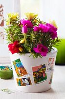 Plant pot decorated with postage stamps
