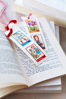 Hand-crafted bookmarks decorated with postage stamps