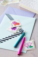 Pens, decorated envelopes & decorative postage stamps
