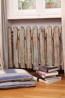 Radiator cover made of picket fence