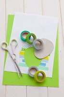 Things for decorative Easter egg made with paper and colorful masking tapes