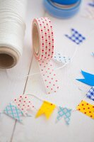 Making decorative flags with masking tape and string