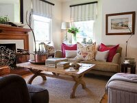 Various upholstered seating around wooden coffee table in country-style living room