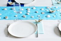 Place setting on table with maritime decorations