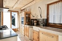 Open-plan kitchen with rustic kitchen counter & solid wood base units