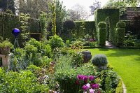 Flowering garden with English-style, artistic box topiary