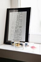 Framed message on window sill