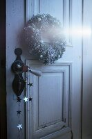 Christmas wreath on vintage interior door