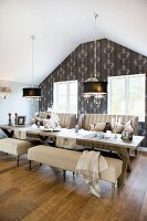 Elegant, country-house-style, attic dining room with antique furniture and rustic dining table