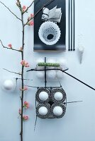Abstract arrangement with cable ties, eggs and flowering branch