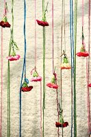 Pinks tied to thread curtain