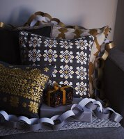Scatter cushions and Christmas presents draped with paper garlands