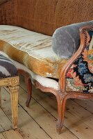 Wooden-framed Baroque-style bench with different fabrics on cushions and sides