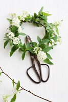 Wreath of spirea and vintage garden scissors