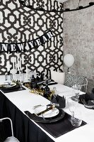 Table decorated in black and white for New Year party