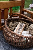 String and ball of yarn in wicker basket