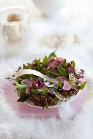 Wreath of hellebores as festive centrepiece