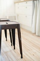 Classic metal stools on wooden kitchen floor
