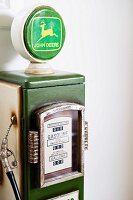 Vintage petrol pump against wall