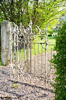 Sunny garden with wrought iron gate