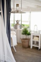 Retro oil lamp hanging from ceiling in rustic setting