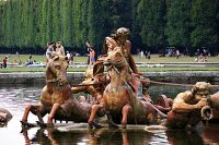 Metal horse figures in the Apollo Fountain in the Garden of the Palace of Versailles