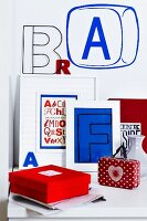 Arrangement of letter ornaments, framed letters and wall stickers